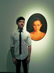 Aaron Nagel alongside his work