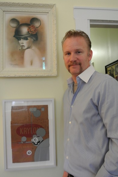 Morgan Spurlock at home alongside works from Brian M. Viveros and Dalek (aka James Marshall)